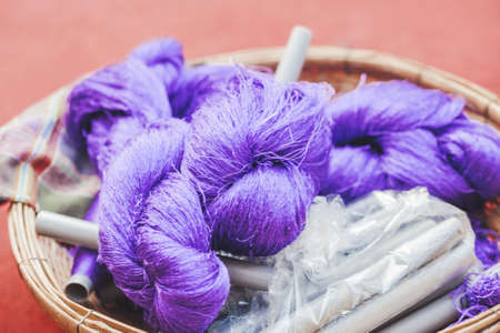 Coils of violet colored silk thread. Natural product silkworm butterflies cocoons. Manual production of silk fabric. Bangkok, Thailand.