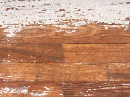 Shabby wooden boards with peeling white paint. Old scratched boards.