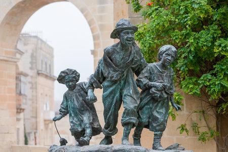 VALLETTA, MALTA - February 20, 2010. Les Gavroches, bronze sculpture by Antonio Sciortino, depicting Parisian street children in Upper Barrakka Garden. Sajtókép