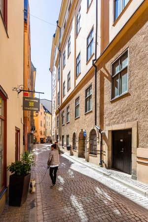 STOCKHOLM, SWEDEN - July 06, 2017. Bright sun reflections on narrow street in historical part of Stockholm. Old fashioned building in Gamla stan, old part of town.