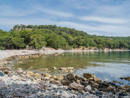 Panorama view of North Harbor of Phaselis. Ruins of Greek city on the coast of ancient Lycia. Architectural landmark near modern town Tekirova in Kemer district of Antalya Province in Turkey.