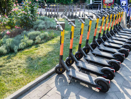 SOCHI, RUSSIA - May 27, 2021. Kick scooters for rent in urban park. Eco-friendly and comfortable urban transport for tourists and locals. Redactioneel