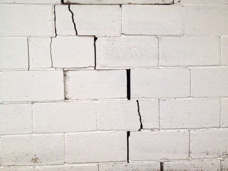 crack: Large crack in a concrete wall.