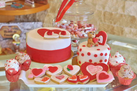 Valentine's Day special decorated cake, cookies, cupcakes.