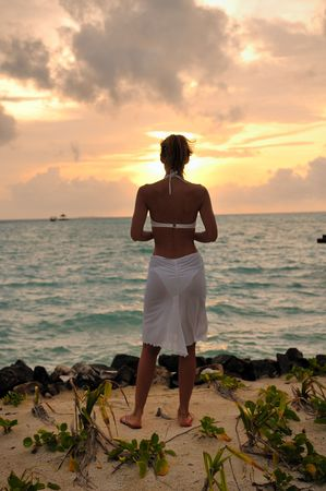 Girl sitting on Sunrise Beach Shore photo