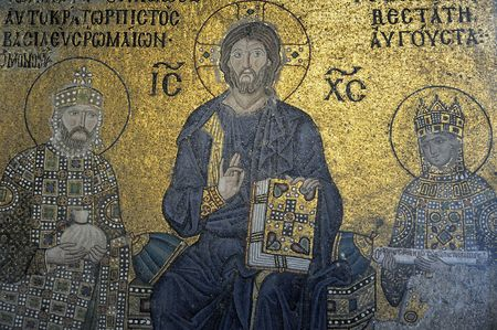 byzantine: The Empress Zoe mosaics on the eastern wall of the southern gallery date from the 11th century. Christ Pantocrator, clad in the dark blue robe (as always the custom in Byzantine art), is seated in the middle against a golden , giving His blessin Stock Photo