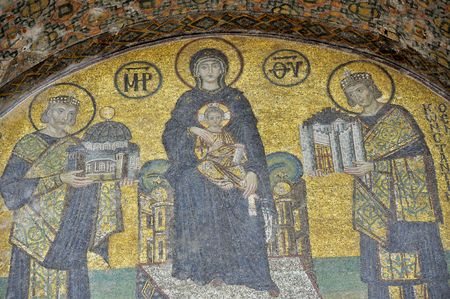 wikipedia: The Comnenus mosaics, equally located on the eastern wall of the southern gallery, date from 1122. The Virgin Mary is standing in the middle, depicted, as usual in Byzantine art, in a dark blue gown. She holds the Child Christ on her lap (wikipedia). Stock Photo