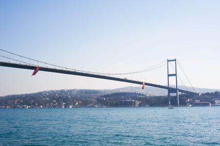 bosphorus: The Bosphorus Bridge, also called the First Bosphorus Bridge (Turkish: Bo�azi�i K�pr�s� or 1. Bo�azi�i K�pr�s�) is one of the two bridges in Istanbul, Turkey spanning the Bosphorus strait (Turkish: Bo�azi�i).