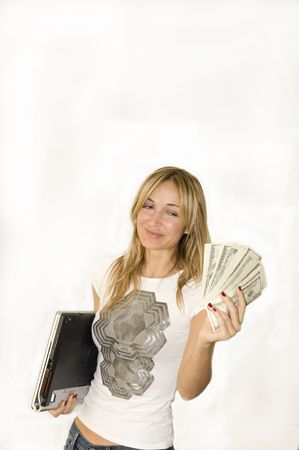 Beautiful young woman makes money with laptop.  photo