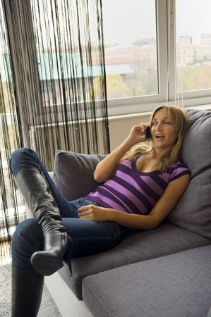 woman having a happy conversation on her cell-phone photo