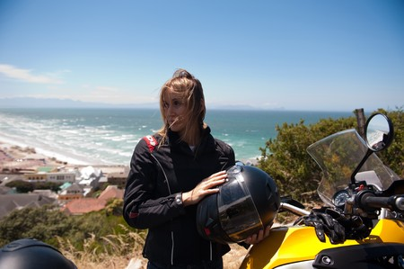 A motorcycle portrait of a beautiful young woman. photo