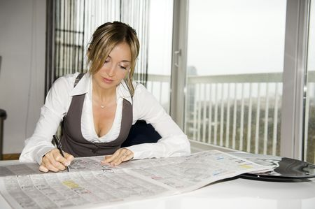 beautiful young woman reding newspaper photo