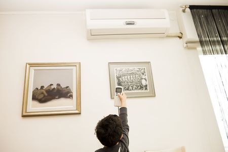 boy remote air conditioning photo