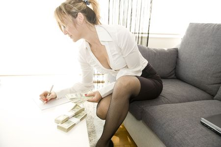 sexy businesswoman: Beautiful isolated business money woman Stock Photo
