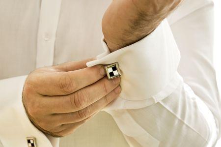 Cuff with cufflink being put on Stock Photo - 5090023