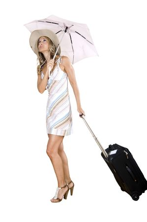 woman walking with her suitcase under an umbrella photo