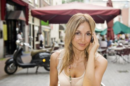 Young woman at outdoor cafe Stock Photo - 5477939