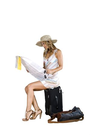 traveler woman searching for her destination on the map Stock Photo