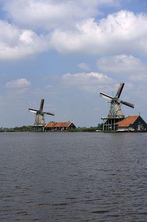 Dutch windmill on a canals edge  photo