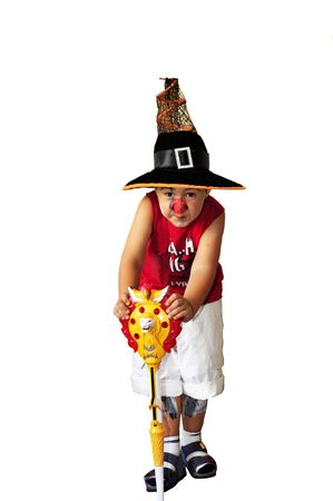 Portrait of a child dressed up as witch for a costum party. Isolated on white background. Stock Photo - 5688256