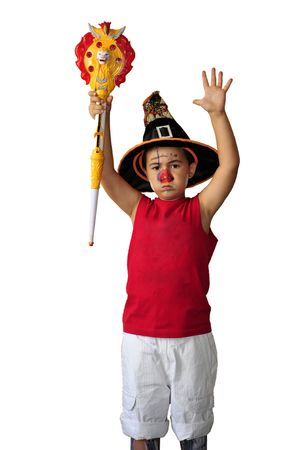 costum: Portrait of a child dressed up as witch for a costum party. Isolated on white background.