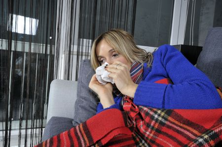 young woman blowing her nose with tissue. photo