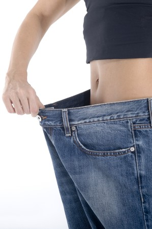 woman showing how much weight she lost Stock Photo