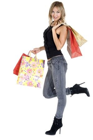 sexy blond woman with shopping bags smiling happily photo
