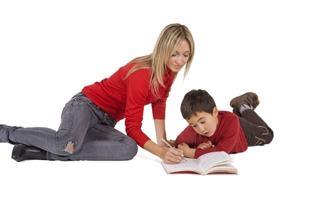 difficult lives: mother helping son with her homework  Stock Photo