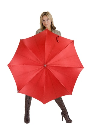 happy smiling woman with her raincoat and umbrella photo