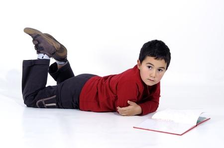 school boy reading a book Stock Photo - 9636939