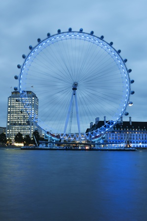 millennium wheel: London, September 2011-The London Eye and the Thames River at night. The EDF Energy London Eye (commonly the London Eye, or Millennium Wheel, formerly the Merlin Entertainments London Eye and before that, the British Airways London Eye) is a 135-metre (44
