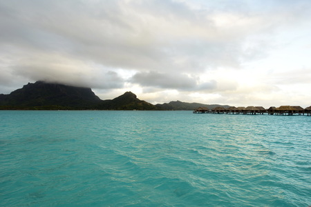 Bora Bora. View over beautiful blue lagoon to volcanic Mount Otemanu, Bora Bora Island, French Polynesia. photo