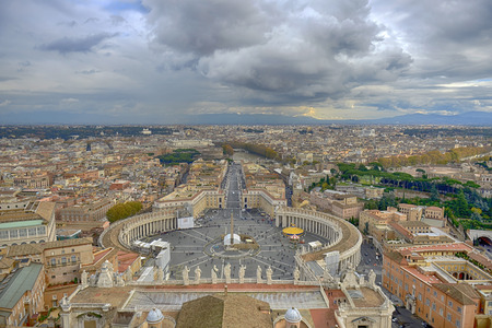 Piazza San Pietro (St. Peters Square), a large elliptical shaped square in front of the St. Peters Basilica in Rome.