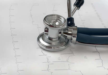 stethoscope and ECG on white background photo