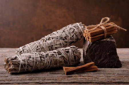Dried white sage smudge sticks for relaxation and aromatherapy. Essential incense for esoteric rituals .Organic burning sage smudge.