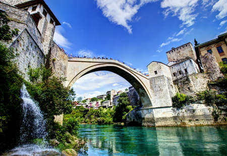 neretva: Stari Most is a reconstruction of a 16th-century Ottoman bridge in the city of Mostar in Bosnia and Herzegovina that crosses the river Neretva Stock Photo