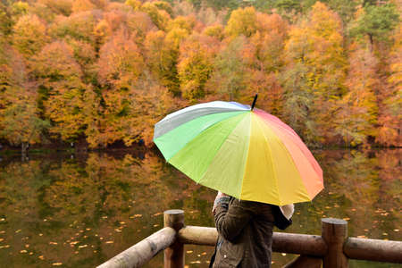 Girl with the colorful umbrella at the Seven Lakes National Park Stock Photo