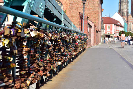 Padlocks at Tumski Bridge, connecting old town and Sand Island of Wroclaw with Cathedral Island, Wroclaw, Poland