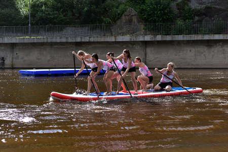 Girls racing team are paddling in Jizera River, Bohemian Paradise