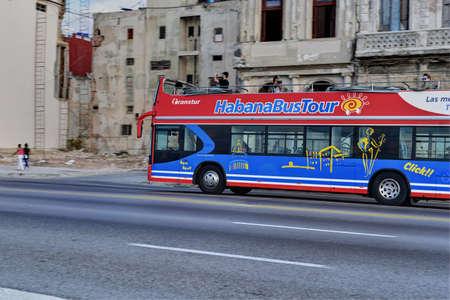 Double-decker bus for sightseeing on the Malecon esplanade, old town Habana Vieja, Havana, Cuba