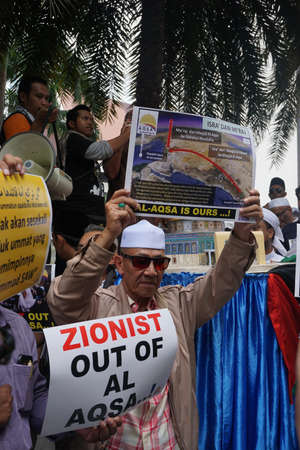 KUALA LUMPUR, MALAYSIA - 21 July 2017:Protesters gather to protest the closure of Al-Aqsa Mosque and holding banners Save Palestine