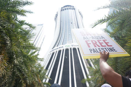 KUALA LUMPUR, MALAYSIA - 21 July 2017:Protesters gather to protest the closure of Al-Aqsa Mosque and holding banners Save Palestine Free Al-aqsa against Israeli Governments at Tabung Haji Building Editorial