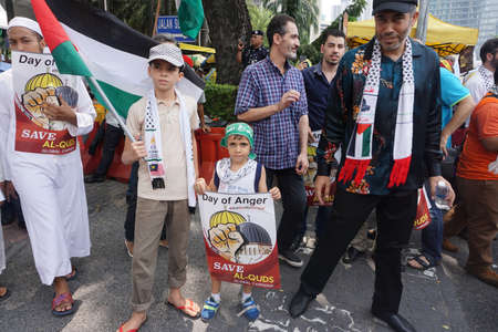 israeli: KUALA LUMPUR, MALAYSIA - 21 July 2017:Protesters gather to protest the closure of Al-Aqsa Mosque and holding banners Save Palestine Free Al-aqsa against Israeli Governments at Tabung Haji Building Editorial