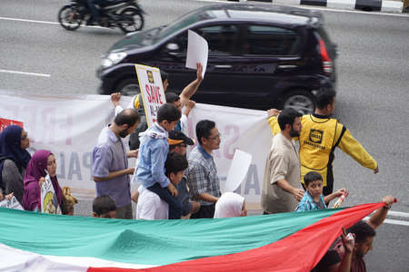 goverment: KUALA LUMPUR, MALAYSIA - 21 July 2017:Protesters gather to protest the closure of Al-Aqsa Mosque and holding banners Save Palestine Free Al-aqsa against Israeli Governments at Tabung Haji Building Editorial