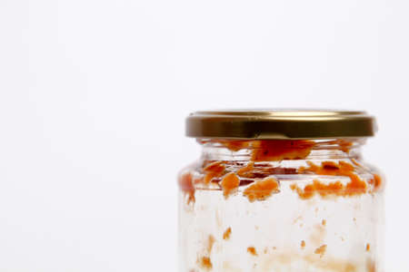 Open Glass jar with delicious homemade classic spicy tomato pasta or pizza sauce isolated white background