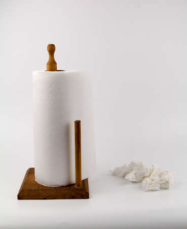 White paper towel rolls on stand holder isolated white background