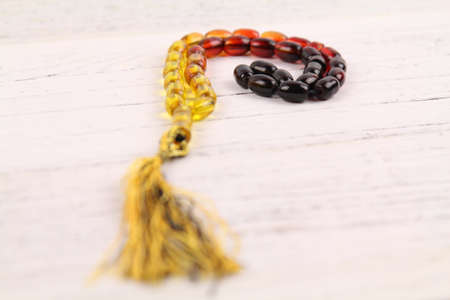 tasbih or rosary (moslem prayer beads) at wooden board