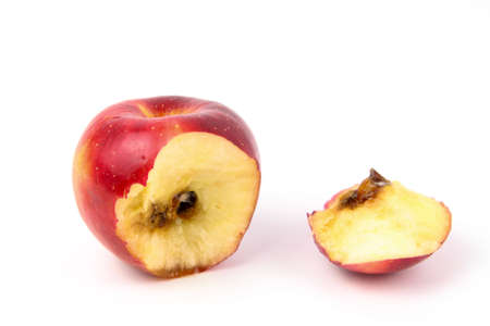 A bitten red apple rotten from inside isolated white background Stock Photo