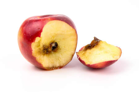 A bitten red apple rotten from inside isolated white background 写真素材
